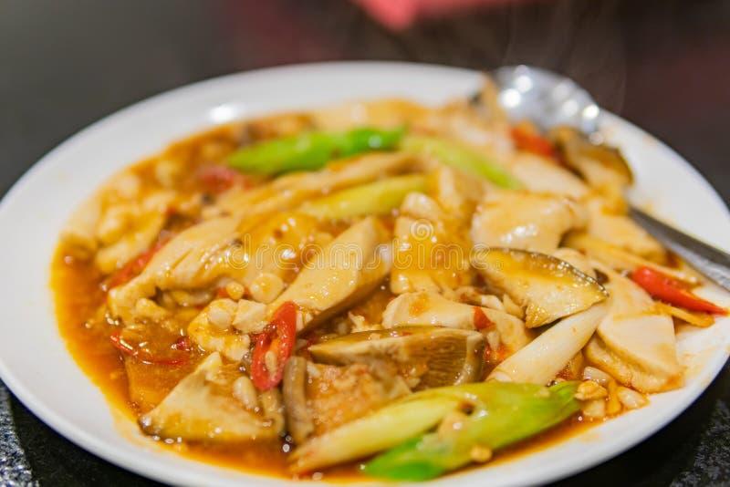 Close up shot of a dish of fried tofu, swim bladder with mushroom stock images