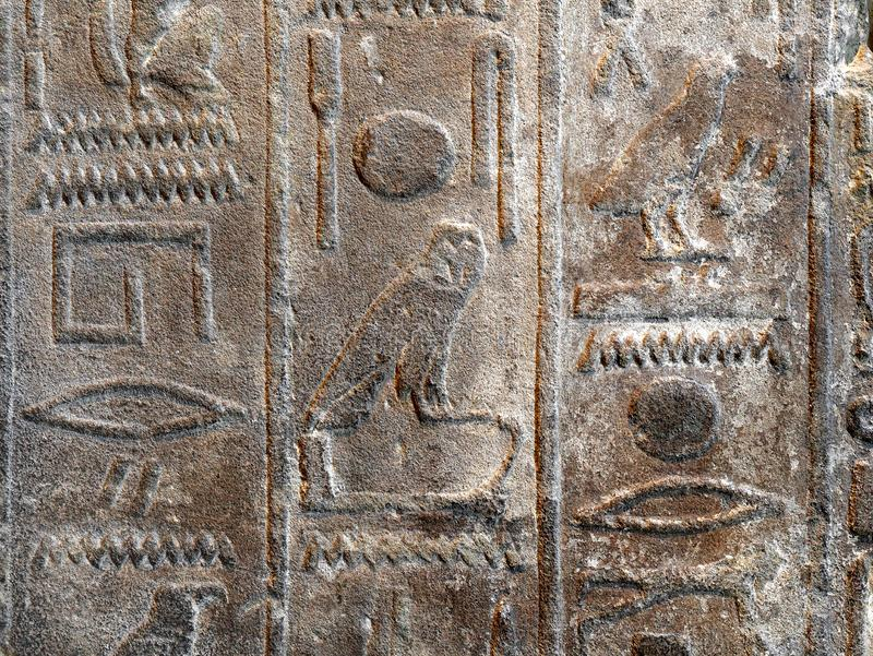 Close up shot of Egyptian hieroglyphics carved into stone royalty free stock photography