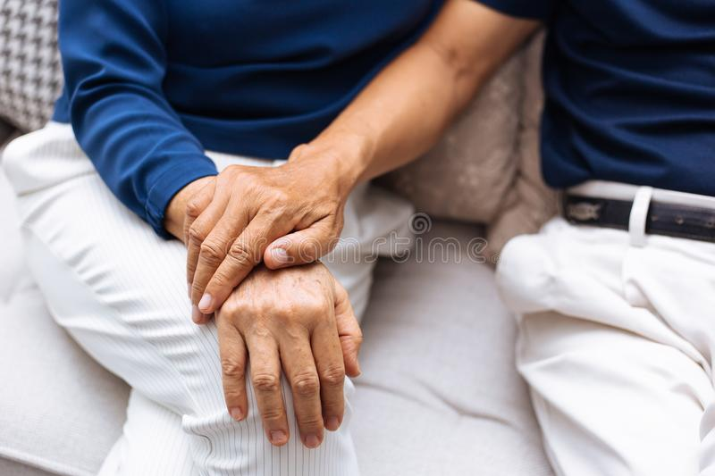 Close up shot of elderly senior couple holding hands and supporting with each other. royalty free stock photography