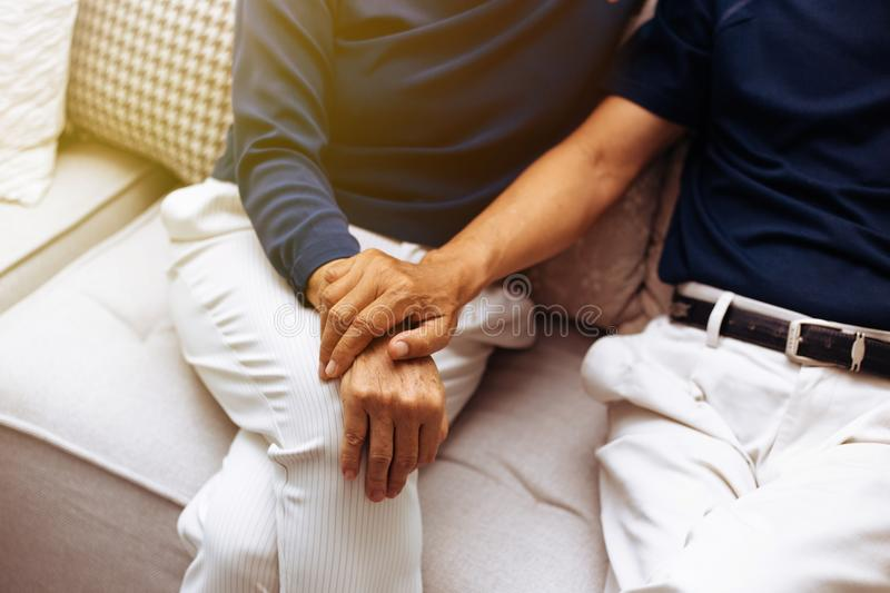 Close up shot of elderly senior couple holding hands and supporting with each other. royalty free stock photos