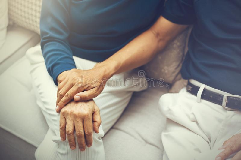Close up shot of elderly senior couple holding hands and supporting with each other. stock image