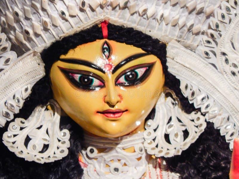 Close up shot of face of an Idol of godess durga mata with beautiful eyes and beautiful facial features royalty free stock photo