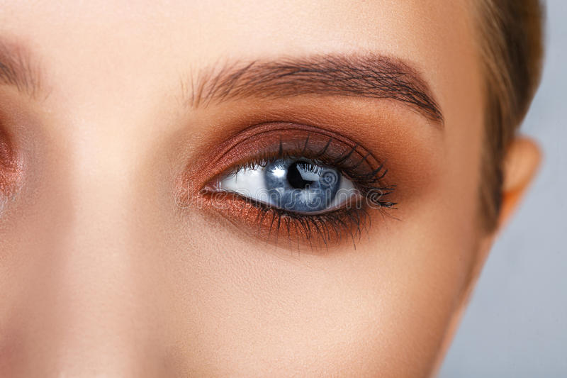 Close-up shot of female eye make-up in smoky eyes style stock photography