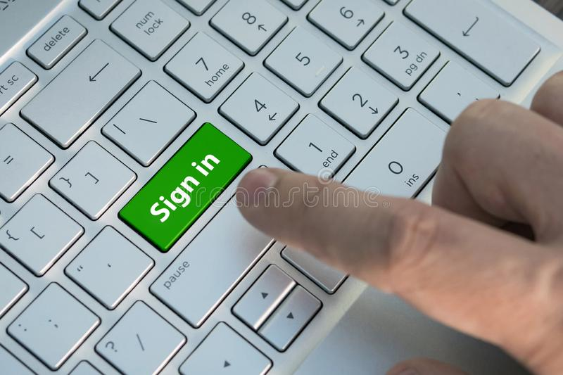Close up shot of a finger clicking the SEND button on a laptop keyboard, A male finger presses a color button on a gray silver stock images