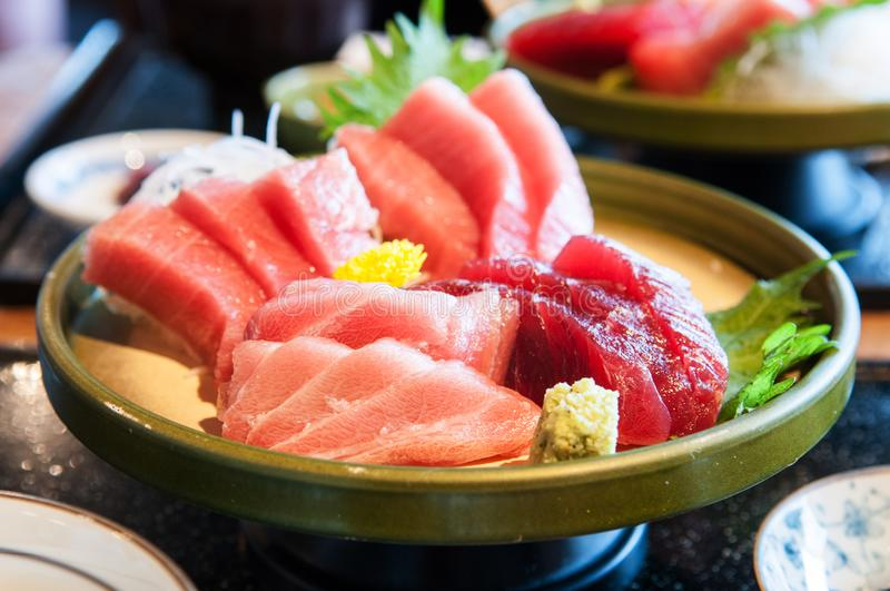 Close up shot of Fresh salmon, tuna, toro, maguro, otoro sashimi with wasabi on ceramic plate. Close up shot of Fresh salmon, tuna, toro, maguro, otoro mix royalty free stock images
