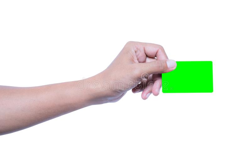 Close-up shot of green credit card. Holded by hand on white isolated background, Financial concept stock photography