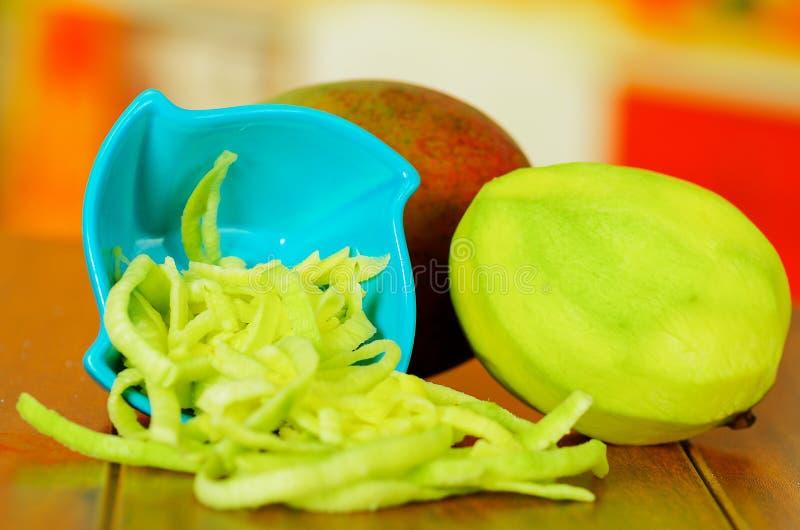 Close up shot of green fresh sliced mango stock image