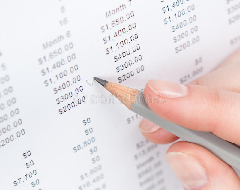 Close up shot of hand making notes in the document stock photography