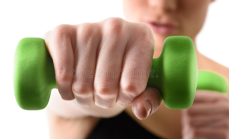 Close up shot of hand by training woman with green royalty free stock photography