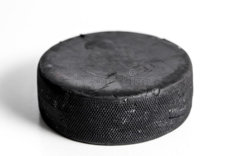 Hockey Puck. Close up shot of a hockey puck on a white background stock image