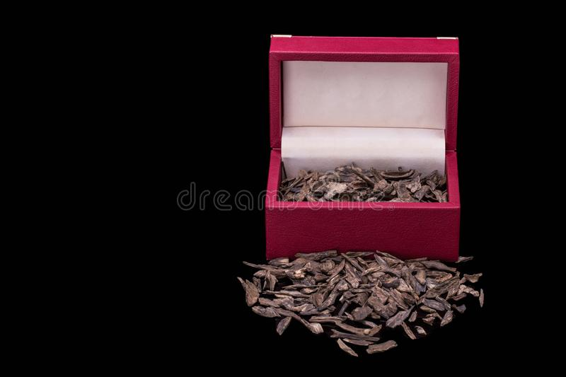 Close Up Shot Of Incense Sticks And Chips Of Agar Wood Or Agarwood In A Red Container Gift Box Isolated On Black Background Used stock photos