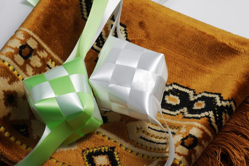 Close up shot of ketupat. Ketupat in Indonesian and Malay is a type of dumpling made from rice packed inside a diamond-shaped container of woven palm leaf pouch stock images