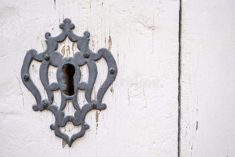 Close up shot of a keyhole with a decorated key plate royalty free stock image