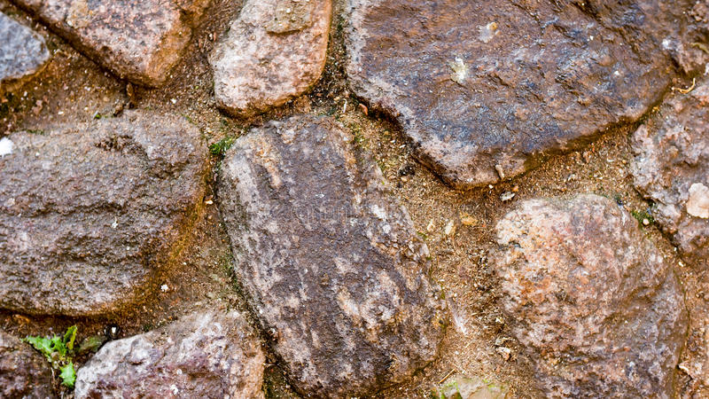 Close-up shot of large stones on cobbed area for background. Large stones with ground between, close-up shot for background stock photo