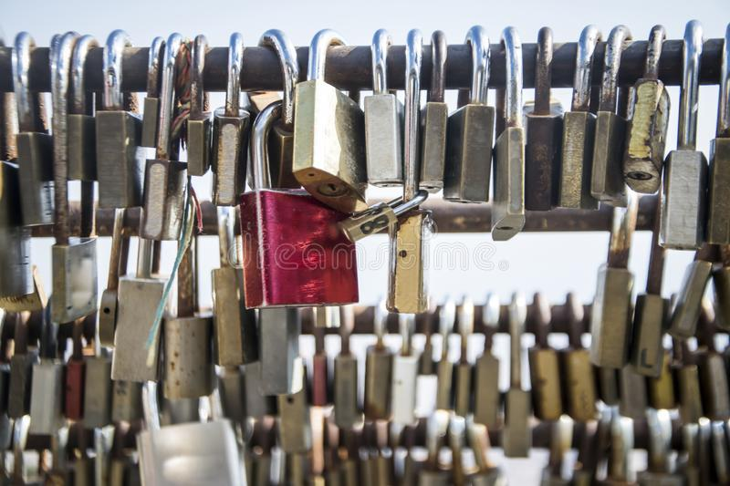 Love Lock Fence. A close-up shot of love locks on a fence stock images