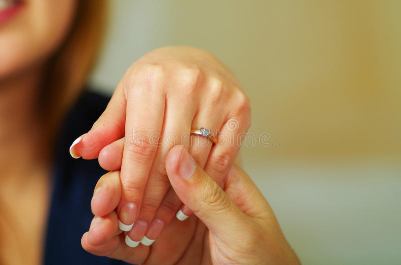 Close up shot of man holding a hand of a woman. Close up shot of hand of man proposing to a woman royalty free stock photo