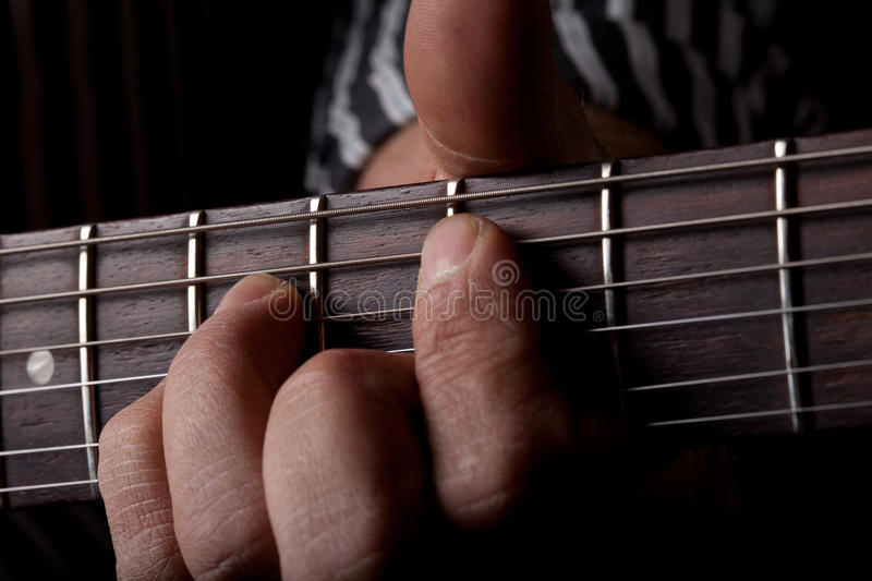 Download Close Up Shot Of A Mans Left Hand Playing Guitar Stock Photo - Image: 24729328