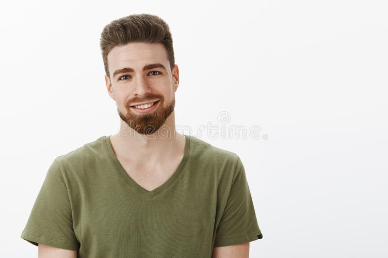 Close-up shot of nice romantic and cute boyfriend with beard gazing with love at camera grinning happily and tilting. Head as enjoying watching beautiful royalty free stock images