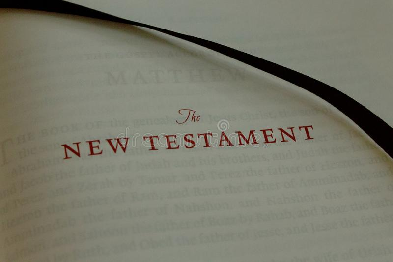 Close up of old letters spelling The New Testament in an old bible royalty free stock photos