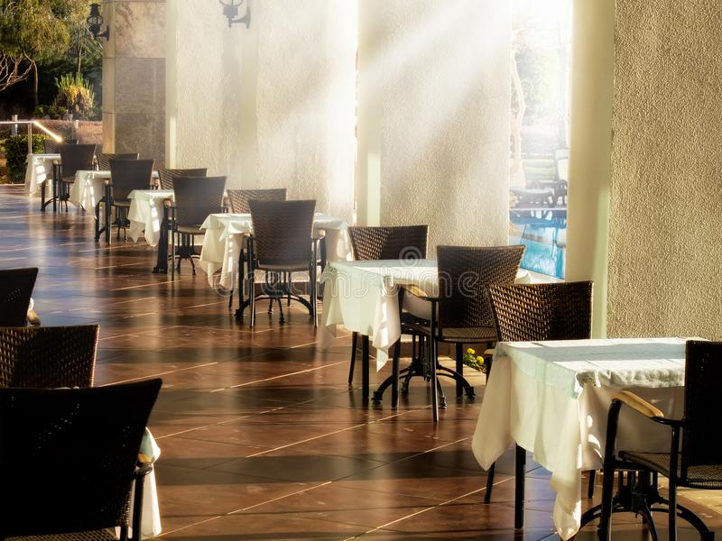 Close up restaurant tables and sunbeam royalty free stock images