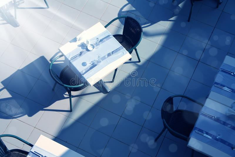 restaurant table and chairs stock photography