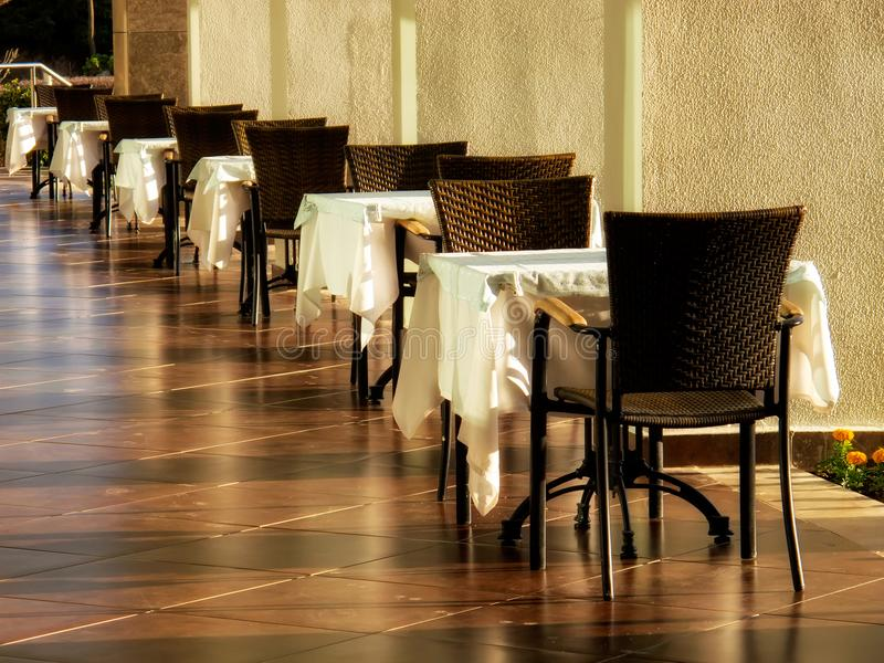 restaurant tables and chairs stock photography