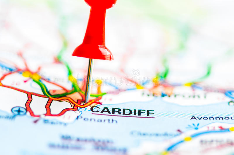Close-up shot over Cardiff City On Map, Wales, United Kingdom. Red pushpin showing Cardiff City On Map, Wales, United Kingdom, Travel Destination Concept royalty free stock photography