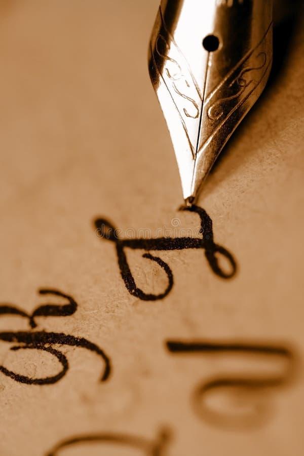 Close up shot of pen nib. Extreme close up shot of pen nib and text royalty free stock image