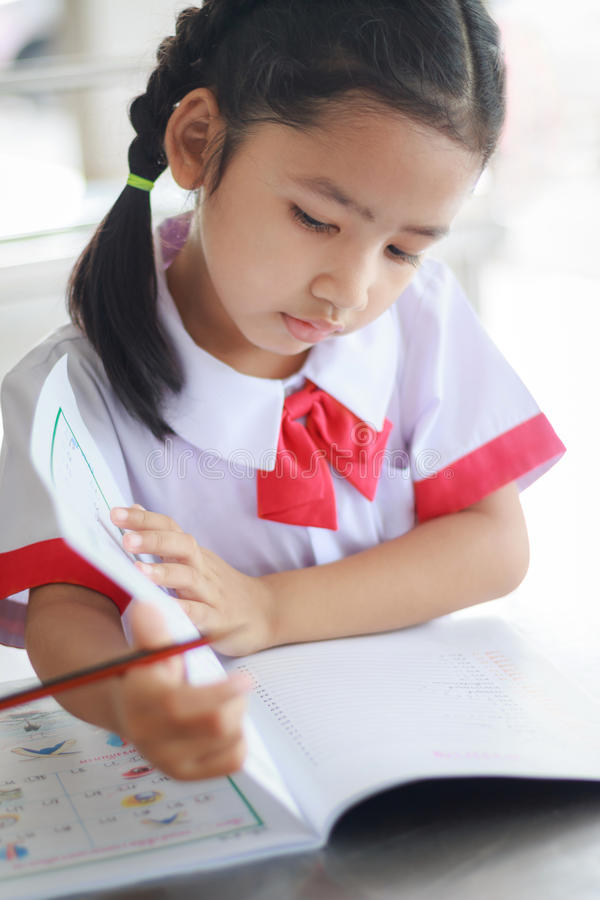 Close up shot Potriat of Asian little girl sitting and doing homework royalty free stock images
