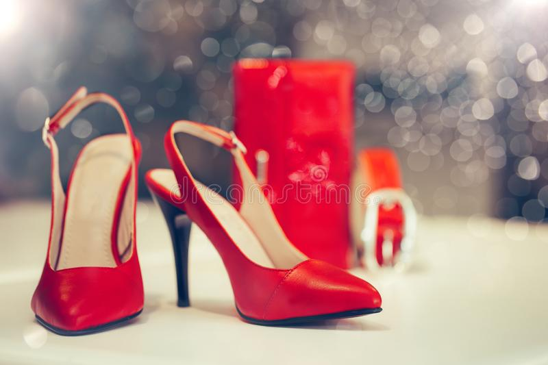 Close up shot of red elegant high heel women shoes, with woman wallet and belt stock images