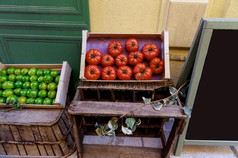 Close-up shot of red and green tomatoes selling on street of old european town,. Antibes, France royalty free stock images