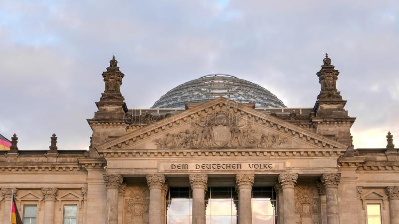 Close up of the reichstag pediment and dome in berlin, germany stock image