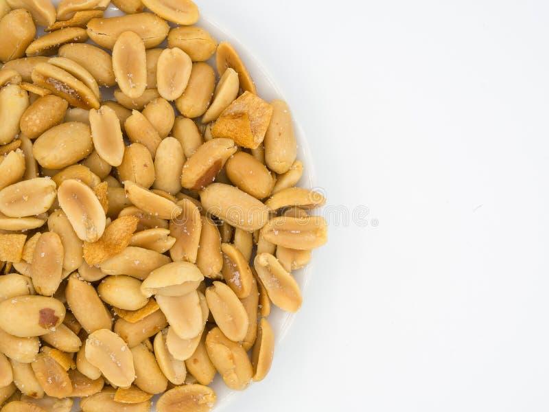 Close up shot of roasted peanuts and sliced garlics seasoning wi royalty free stock photo