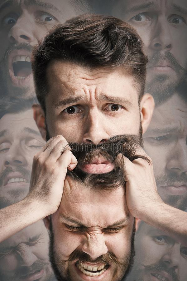 Close up shot of sad and angry emotion on face of discouraged man stock photo