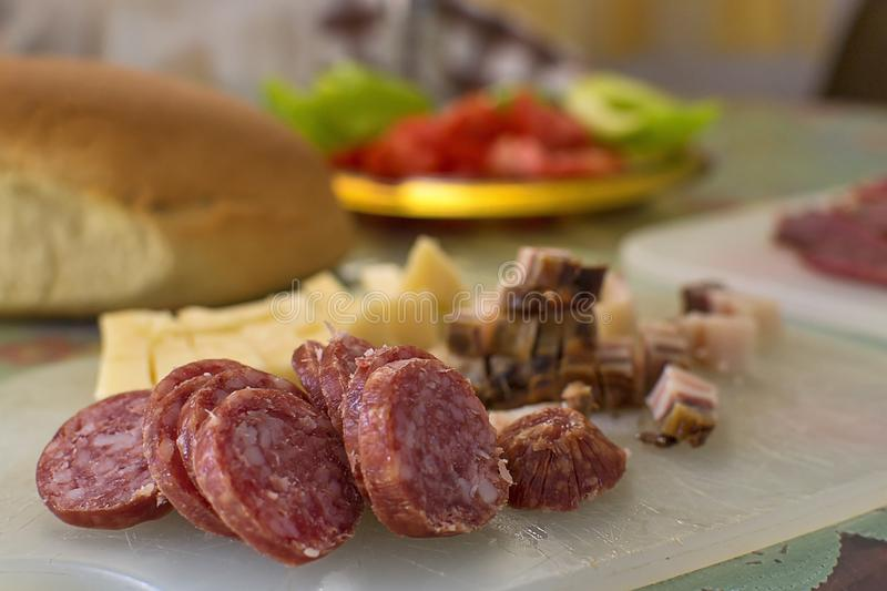 Serbian breakfast with sliced domestic sausage, bacon, ham and cheese. stock photos