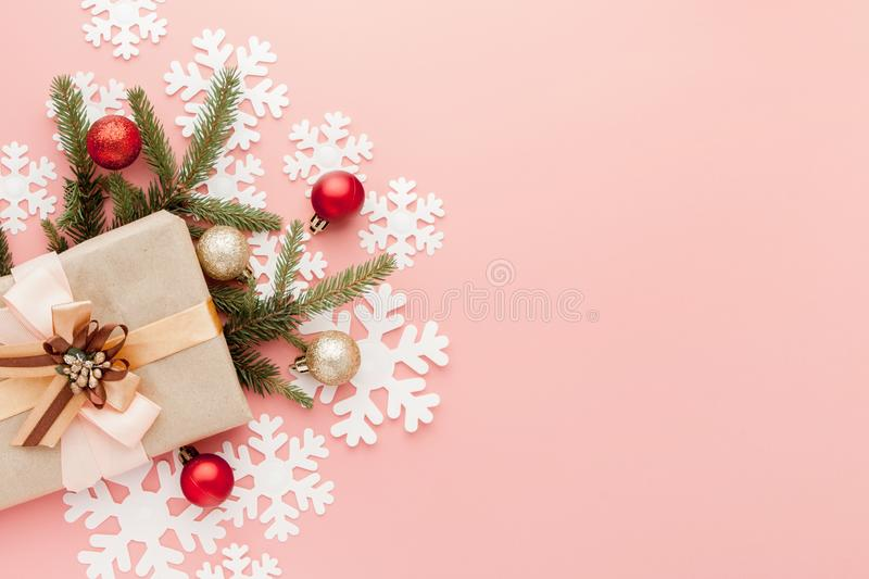 Close up shot of small gift wrapped with ribbon on pink background. Christmas background. Minimal concept. Flat lay. Top view stock photo