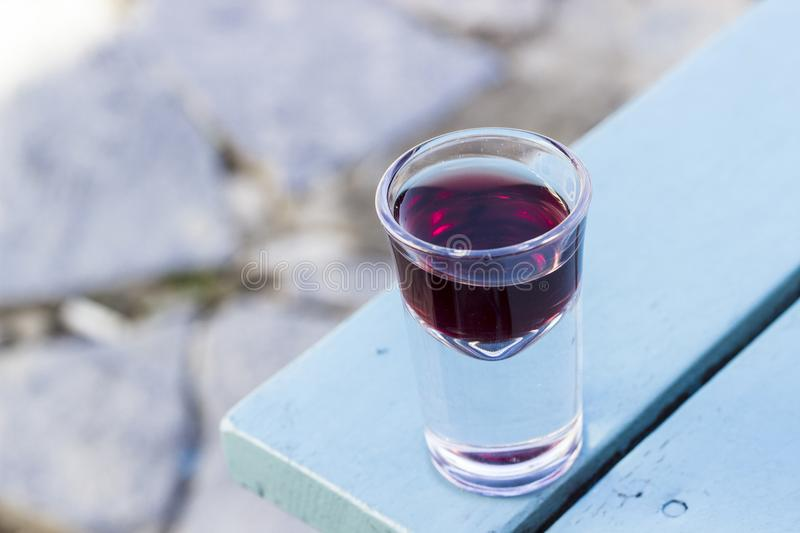 Close up shot of small wine shot glass for purpose of taste in Turkey at afternoon. At sunset stock images