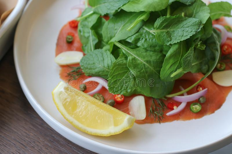 Close up shot of smoke salmon salad in white plate. stock images