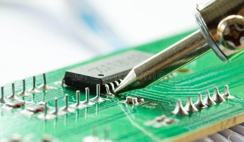 Close up shot of soldering iron stock images