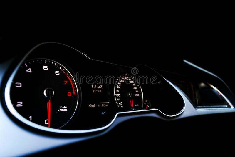 Close up shot of a speedometer in a car. Car dashboard. Dashboard details with indication lamps.Car instrument panel. Dashboard wi royalty free stock photos