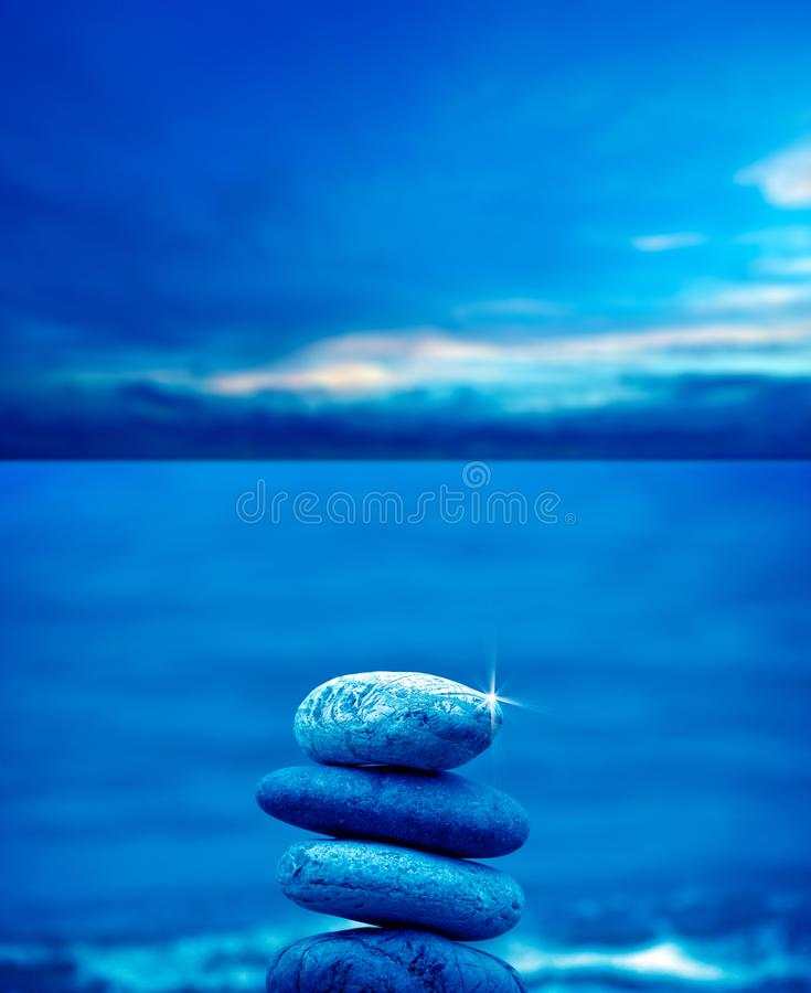 Stone pile on beach. Close up shot of stone pile over sea and morning sky stock image