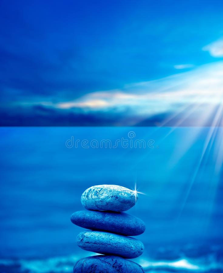 Stone pile on beach. Close up shot of stone pile over sea and morning sky royalty free stock images