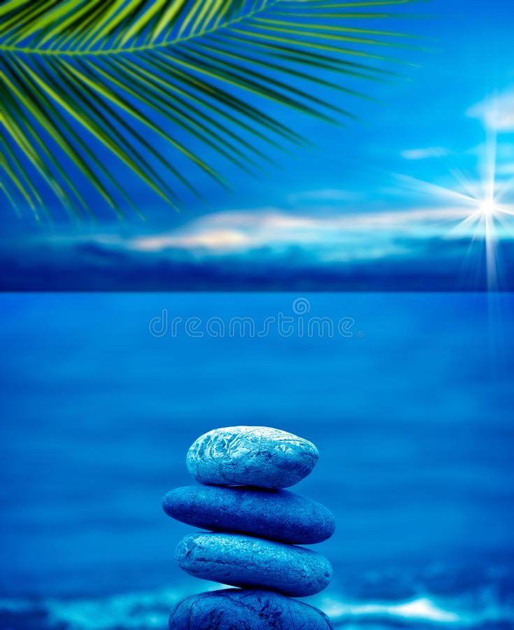 Stone pile on beach. Close up shot of stone pile over sea and morning sky royalty free stock photography