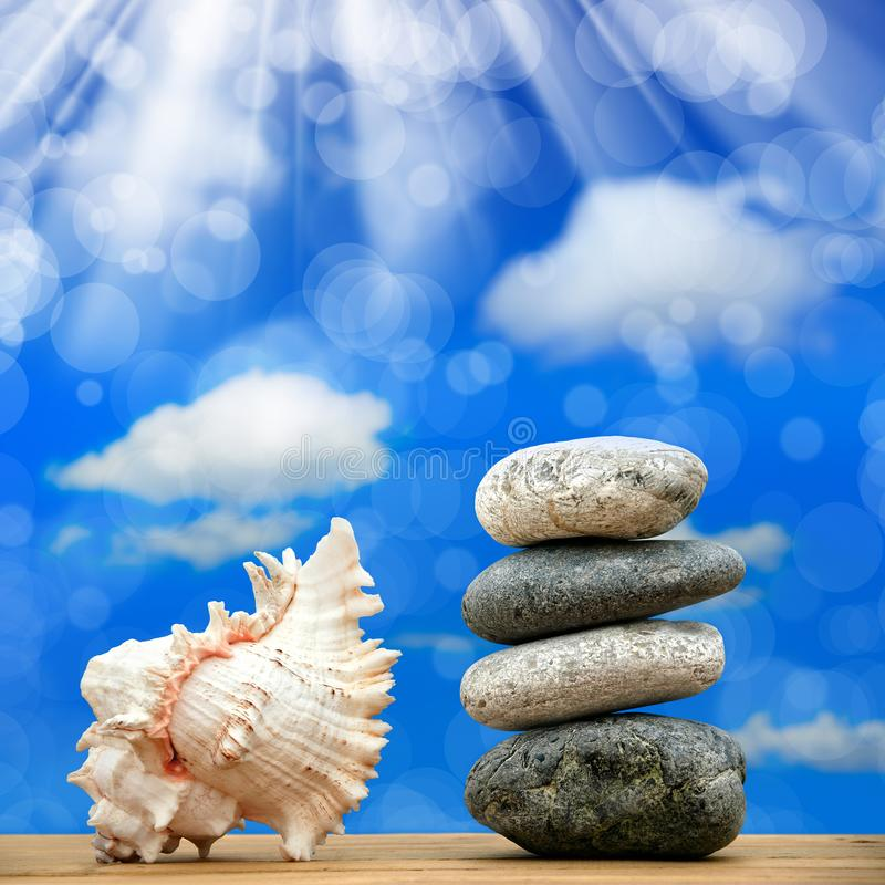 Stone pile on beach. Close up shot of stone pile and seashell over sunny sky stock image