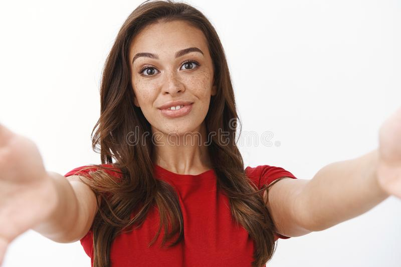 Close-up shot tender cute feminine young happy woman, smiling silly stretch hands forward as holding camera, taking royalty free stock image