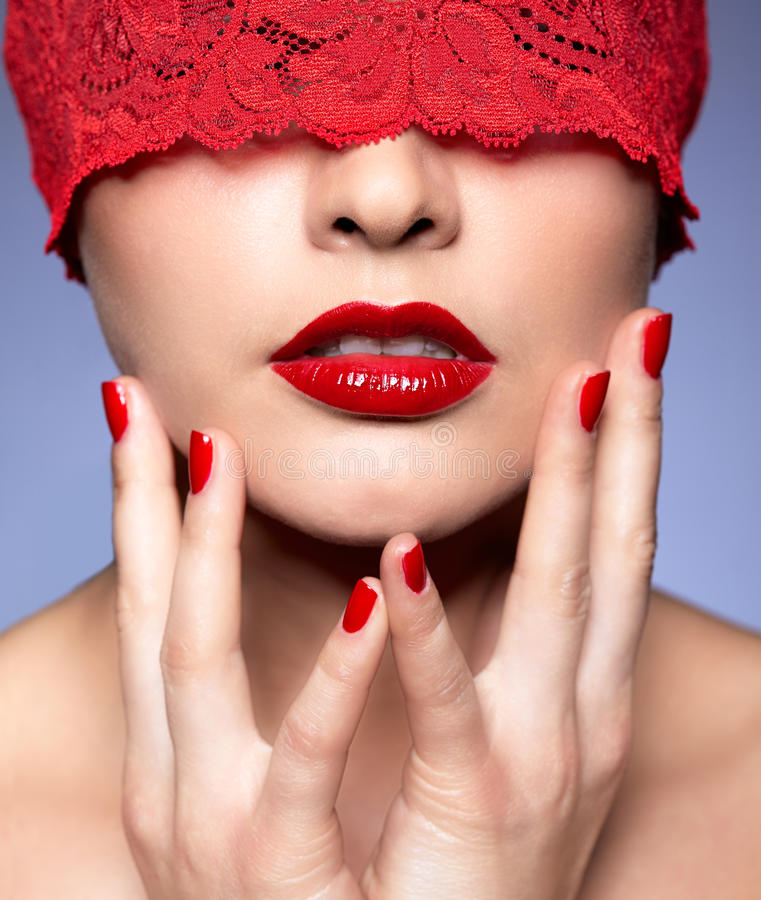 Close-up shot of Woman with red lacy ribbon on eye royalty free stock photography