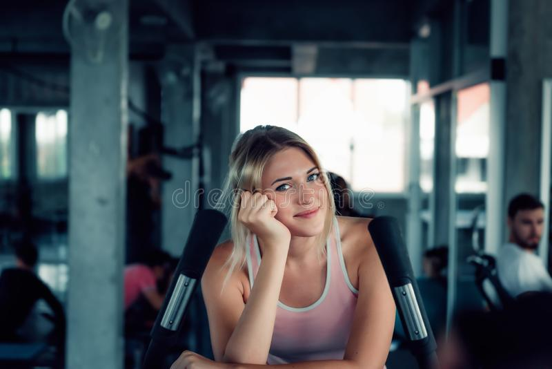 Sporty Woman Workout Cycling Exercise in Fitness Club, Portrait of Pretty Attractive Caucasian Woman is Exercising Bike Cycling Tr stock photo