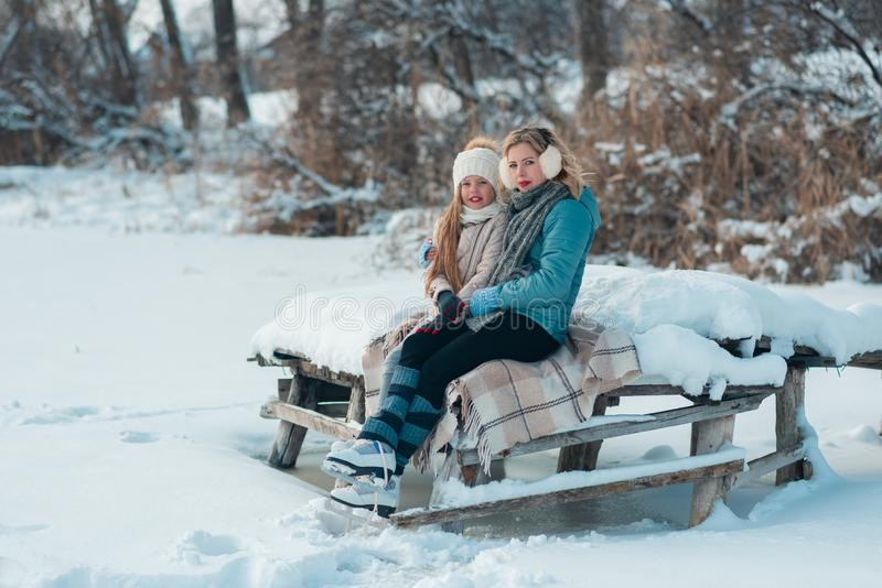 Close up shot of a women and child in ice skates looking and smile stock image