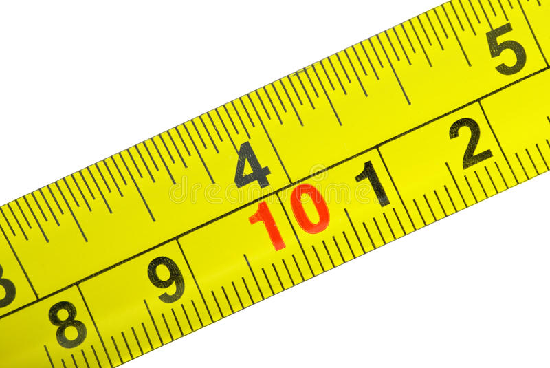 Close-up shot of yellow metal measurement tape royalty free stock images
