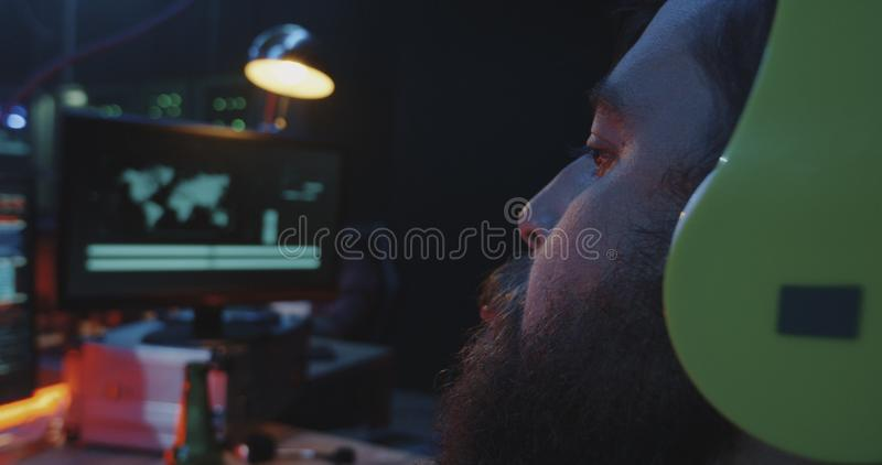 Hacker smoking and spreading computer virus royalty free stock photography